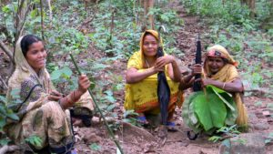 Photo: Green-warriors; three women, part of the women's village forest committee of Dengajhari (Nayagarh district, Odisha) who patrol their community forest (Credit: Sharad Lele).